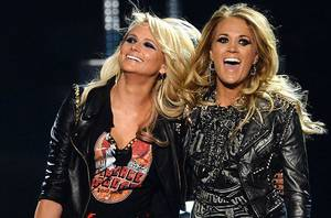 Photo - LAS VEGAS, NV - MAY 18:  Recording artists Miranda Lambert (L) and Carrie Underwood perform onstage during the 2014 Billboard Music Awards at the MGM Grand Garden Arena on May 18, 2014 in Las Vegas, Nevada.  (Photo by Ethan Miller/Getty Images)