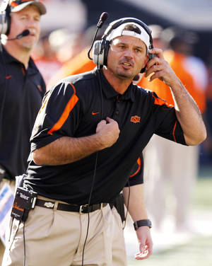 Photo - Joe DeForest, associate head coach/special teams coordinator, at the Oklahoma State University (OSU) college football game against Baylor University. PHOTO BY DOUG HOKE, THE OKLAHOMAN