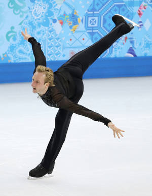 Photo - Evgeni Plushenko of Russia competes in the men's team free skate figure skating competition at the Iceberg Skating Palace during the 2014 Winter Olympics, Sunday, Feb. 9, 2014, in Sochi, Russia. (AP Photo/Vadim Ghirda)