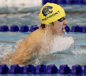 Photo - Piedmont's Conner St. John competes in the second heat of the Class 5A boys 200-yard IM during the west regionals for high school swimming at the Mitch Park YMCA in Edmond, Okla., Saturday, Feb. 15, 2014. Photo by Nate Billings, The Oklahoman