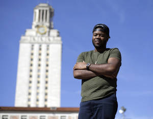 Photo - In this March 5, 2013 photo, University of Texas senior Bradley Poole, 21, poses for a photo on the campus in Austin, Texas. Poole, an advertising major, became president of the school's Black Student Alliance, seeking camaraderie after noticing he often was the only African-American in his classes. In two pivotal legal cases, one on affirmative action and another on voting rights, a divided U.S. Supreme Court may be poised in the coming weeks to rule that racism is largely a relic of America's past. The question is apt as the nation nears a demographic tipping point, when non-whites become the country's majority for the first time. (AP Photo/Eric Gay)