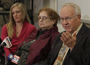 Photo -   Dell Phillips, father of murder victim Kimberly Vaughn, speaks at a news conference accompanied by, from left, Kimberly's twin sister, Jennifer Ledbetter, and her mother Susan Phillips, Tuesday, Nov. 27, 2012 in Joliet, Ill. A judge sentenced Kimberly's husband Christopher Vaughn to four consecutive life setences this morning for the killing of Kimberrly and their three school-age children in June of 2007. (AP Photo/M. Spencer Green)