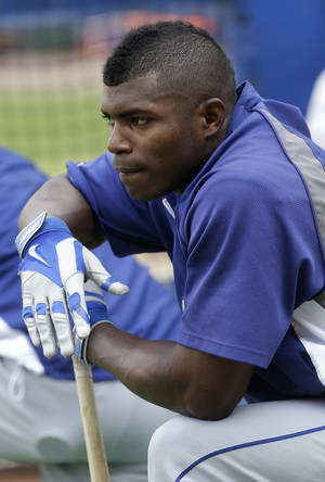 Photo - Los Angeles Dodgers right fielder Yasiel Puig looks on before Game 2 of the National League Division Series against the Atlanta Braves, Friday, Oct. 4, 2013, in Atlanta. (AP Photo/Dave Martin)