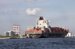 photo -   In this Thursday, Sept. 27, 2012 photo, a container ship passes the Florida Power & Light Port Everglades Plant on its way to unload its cargo at Port Everglades in Fort Lauderdale, Fla. U.S. wholesale businesses increased their stockpiles in September at the fastest pace in nine months and their sales jumped by the largest amount in 18 months, the Commerce Department announced Friday, Nov. 9, 2012. The increases point to stronger economic growth. (AP Photo/Wilfredo Lee)