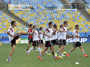 Photo - Germany's team exercises during an official training session one day before the World Cup quarterfinal soccer match between Germany and France at the Maracana Stadium in Rio de Janeiro, Brazil, Thursday, July 3, 2014. (AP Photo/Martin Meissner)