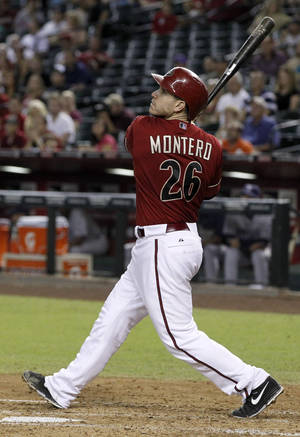 Photo -   Arizona Diamondbacks' Miguel Montero watches his RBI double against the San Diego Padres in the fourth inning of a baseball game Wednesday, Sept. 19, 2012, in Phoenix.(AP Photo/Ross D. Franklin)