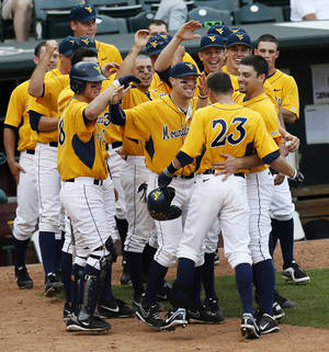 Photo - OKLAHOMA STATE UNIVERSITY / OSU / COLLEGE BASEBALL / BIG 12 TOURNAMENT / CELEBRATION: The West Virginia Mountaineers celebrate with Brady Wilson (23) after hit hit a home run to tie the game at 5-5 in the sixth inning during an NCAA baseball game between Oklahoma State and West Virginia in the Big 12 Baseball Championship tournament at the Chickasaw Bricktown Ballpark in Oklahoma City, Saturday, May 25, 2013. WVU beat OSU 6-5 in ten innings. Photo by Nate Billings, The Oklahoman