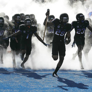 Photo -   Boise State's Lee Hightower (29) is the first to take the field as Boise State wears black uniforms for an NCAA college football game against UNLV on Saturday, Oct. 20, 2012 in Boise, Idaho. Boise State won 32-7. (AP Photo/Matt Cilley)