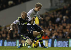 Photo - Tottenham Hotspur's Christian Eriksen, right, competes with Stoke City's Andy Wilkinson during their English Premier League soccer match at White Hart Lane, London, Sunday, Dec. 29, 2013. (AP Photo/Sang Tan)