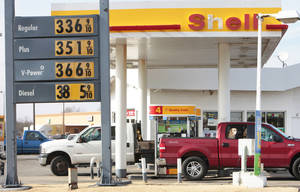Photo - Gas prices are shown Friday at a station on Britton Road near Western.  Photo By David McDaniel, The Oklahoman