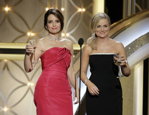 Photo - This image released by NBC shows hosts Tina Fey, left, and Amy Poehler during the 71st annual Golden Globe Awards at the Beverly Hilton Hotel on Sunday, Jan. 12, 2014, in Beverly Hills, Calif. (AP Photo/NBC, Paul Drinkwater)