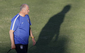Photo - Brazil's coach Luiz Felipe Scolari attends a training session the day before the quaterfinal World Cup soccer match between Brazil and Colombia in Fortaleza, Brazil, Thursday, July 3, 2014.(AP Photo/Andre Penner)