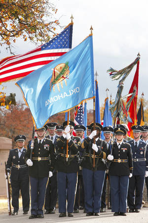 Photo - Members of various honor guards march during the annual Veteran's Day ceremony Saturday at the 45th Infantry Museum in Oklahoma City. Photo By Paul Hellstern, The Oklahoman