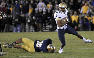 Photo - Notre Dame safety Eilar Hardy slows down Navy wide receiver Shawn Lynch on the final play for Navy in the closing seconds of the second half of an NCAA college football game, Saturday, Nov. 2, 2013, in South Bend, Ind. Notre Dame won 38-34. (AP Photo/Joe Raymond)