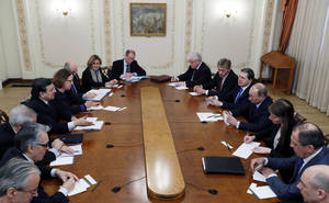 photo - Russian President Vladimir Putin, fourth right, and European Commission President Jose Manuel Barroso, fourth left, meet in the Novo-Ogaryovo residence, outside Moscow, Russia, Thursday, March 21, 2013. The EU and Russia are having one of their biggest spats in recent times over the future of the Cypriot economy. (AP Photo/Yuri Kochetkov, Pool)