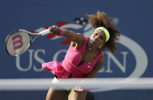 Photo -   Serena Williams serves to Spain's Maria Jose Martinez Sanchez in the second round of play at the 2012 US Open tennis tournament, Thursday, Aug. 30, 2012, in New York. (AP Photo/Darron Cummings)