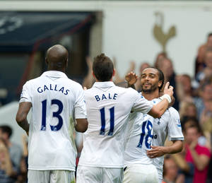 photo -   Tottenham Hotspur's Benoit Assou-Ekotto, right, celebrates after scoring a goal during their English Premier League soccer match against West Bromwich Albion at White Hart Lane stadium, London, Saturday, Aug. 25, 2012. (AP Photo/Tom Hevezi)