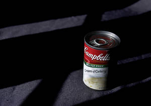 Photo -   FILE-In this Wednesday, Aug. 31, 2011, file photo, light shines on a can of Campbell's soup in Moreland Hills, Ohio. Campbell Soup Co. announced Tuesday, Sept. 4, 2012, that net income rose 27 percent in its fiscal fourth quarter. The results beat analysts' expectations and the food maker gave fiscal 2013 revenue guidance above Wall Street's view. (AP Photo/Amy Sancetta, File)
