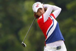 Photo -   Na Yeon Choi of South Korea hits a shot on the 9th hole during the third round of the LPGA Malaysia golf tournament at Kuala Lumpur Golf and Country Club in Kuala Lumpur, Malaysia, Saturday, Oct. 13, 2012. (AP Photo/Lai Seng Sin)