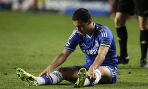 Photo - Chelsea's Eden Hazard looks at his boots as he sits on the ground following a fall during the Champions League semifinal second leg soccer match between Chelsea and Atletico Madrid at Stamford Bridge stadium in London, Wednesday, April 30, 2014. (AP Photo/Matt Dunham)