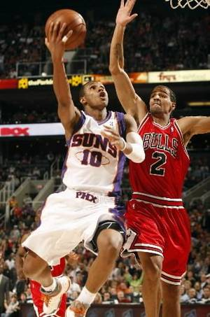 Photo - Phoenix Suns Leandro Barbosa, left drives past Chicago Bulls  Thabo  Sefolosha during the third quarter of an NBA basketball game on Saturday, Jan. 31, 2009, in Phoenix. (AP Photo/Rick Scuteri)