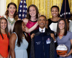 "Photo - FILE - In this July 31, 2013 file photo, University of Connecticut Huskies teammates Stefanie Dolson, top left, and Kiah Stokes, top right, give the 'bunny ears' to President Barack Obama as he poses for photo with the team to honor their 2013 NCAA Women's Basketball Championship win, during a ceremony in the East Room of the White House in Washington. Also seen top center Breanna Stewart, and from bottom left, Caroline Doty, Kaleena Mosqueda-Lewis and Kelly Faris. On Saturday, March 1, 2014, Dolson and fellow senior Bria Hartley will have their names added to the ""Huskies of Honor"" wall at Gampel Pavilion on the UConn campus in Storrs, Conn. (AP Photo/Carolyn Kaster, File)"