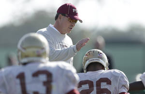 Photo - Florida State head coach Jimbo Fisher greets defensive back P.J. Williams, right, during an NCAA college football practice on Friday, Jan. 3, 2014, in Costa Mesa, Calif. Top-ranked Florida State is to face No. 2 Auburn in the BCS championship game on Jan. 6 in Pasadena, Calif. (AP Photo/Gregory Bull)