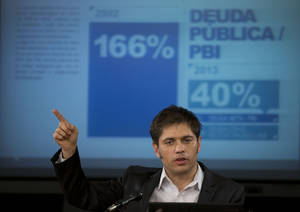Photo - FILE - In this June 17, 2014 file photo, Argentina's Economy MInister Axel Kicillof talks to the media during a news conference to explain the recent U.S. Supreme Court's ruling on Argentina's bond default and discuss how the government plans to proceed, in Buenos Aires, Argentina. For over a decade, Argentina avoided paying $1.5 billion it owed to U.S. hedge funds for defaulted bonds. But after the U.S. Supreme Court refused to intervene in the case this week, the country must pay up by the end of this month. (AP Photo/Eduardo Di Baia, File)