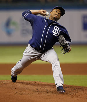 Photo - San Diego Padres starting pitcher Edinson Volquez throws during the first inning of a baseball game against the Tampa Bay Rays, Friday, May 10, 2013, in St. Petersburg, Fla. (AP Photo/Mike Carlson)