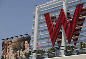 Photo - FILE - A Tuesday, July 17, 2012 file photo, shows Starwood Hotels  W Hollywood hotel logo in Los Angeles.  Starwood Hotels & Resorts Worldwide Inc. reports quarterly earnings on Thursday, April 24, 2014.  (AP Photo/Damian Dovarganes, File)
