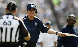 Photo -   Dallas Cowboys head coach Jason Garrett has words with an official in the first half of an NFL football game against the Seattle Seahawks, Sunday, Sept. 16, 2012, in Seattle. (AP Photo/John Froschauer)