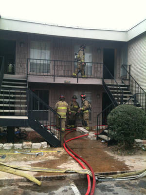 Photo - Firefighters respond to a fire at the Chandelaque Apartment Homes on Friday, December 14, 2012 in Oklahoma City. Photo by Robert Medley, The Oklahoman.