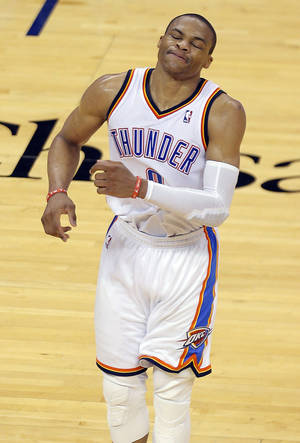 Photo - Oklahoma City's Russell Westbrook (0) reacts after missing a shot during Game 2 in the first round of the NBA playoffs between the Oklahoma City Thunder and the Memphis Grizzlies at Chesapeake Energy Arena in Oklahoma City, Monday, April 21, 2014. Photo by Sarah Phipps, The Oklahoman