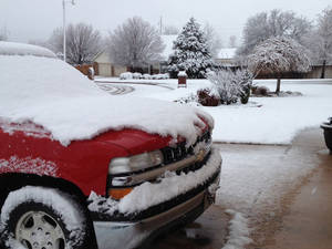 photo - Snow in Midwest City Wednesday morning - Photo by Jim Beckel