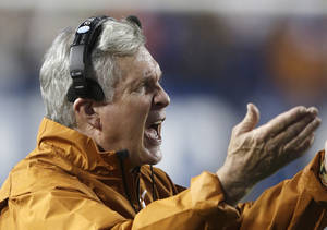 Photo - Texas head coach Mack Brown shouts to his team in the second quarter during an NCAA college football game against Brigham Young, Saturday, Sept. 7, 2013, in Provo, Utah. (AP Photo/Rick Bowmer)