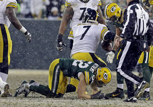 Photo - Green Bay Packers' Clay Matthews holds his hand after sacking Pittsburgh Steelers' Ben Roethlisberger during the first half of an NFL football game Sunday, Dec. 22, 2013, in Green Bay, Wis. Matthews left the game. (AP Photo/Mike Roemer)