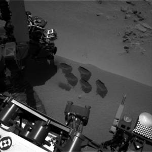 photo -   This image by NASA shows marks in the Martian soil made by the rover Curiosity. The space agency said the six-wheel rover is set to drive to a new destination soon. It landed in August on a two-year mission to study whether the environment is suitable for microbial life. (AP Photo/NASA)
