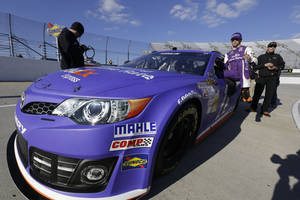 Photo - Denny Hamlin climbs out of his car during qualifying for Sunday's NASCAR Sprint Cup series auto race at Martinsville Speedway in Martinsville, Va., Friday, Oct. 25, 2013. Hamlin won the pole. (AP Photo/Steve Helber)