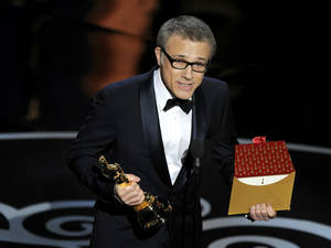 "photo - Actor Christoph Waltz accepts the award for best actor in a supporting role for ""Django Unchained"" during the Oscars at the Dolby Theatre on Sunday Feb. 24, 2013, in Los Angeles.  (Photo by Chris Pizzello/Invision/AP)"