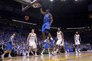 Photo - Brendan Haywood (33) of Dallas dunks the ball against the Thunder defense during game 3 of the Western Conference Finals of the NBA basketball playoffs between the Dallas Mavericks and the Oklahoma City Thunder at the OKC Arena in downtown Oklahoma City, Saturday, May 21, 2011. Photo by Chris Landsberger, The Oklahoman