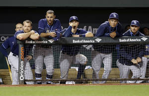 Photo - Members of the Tampa Bay Rays watch from the dugout in the ninth inning of a baseball game against the Baltimore Orioles, Monday, April 14, 2014, in Baltimore. Baltimore won 7-1. (AP Photo/Patrick Semansky)