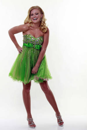 Photo - Model Mary Bold shows off neon green prom dress at Unique Vintage in Burbank, California, April 14, 2012. (Bob Chamberlin/Los Angeles Times/MCT)