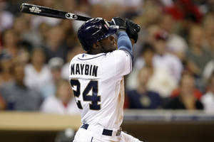 Photo -   San Diego Padres' Cameron Maybin (24) hits a two-run home run against the St. Louis Cardinals during the third inning of their baseball game in San Diego, Calif., Monday, Sept. 10, 2012. (AP Photo/Alex Gallardo)