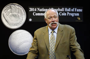 "Photo - Baseball Hall of Famer Rich ""Goose"" Gossage speaks with members of the media, promoting the National Baseball Hall of Fame's new glove-shaped commemorative coin, pictured at left, at the Denver Mint, on Tuesday, May 13, 2014. The limited edition coin celebrates the 75th anniversary of the Hall of Fame, and is the first concave/convex coin ever produced by the U.S. Treasury. (AP Photo/Brennan Linsley)"