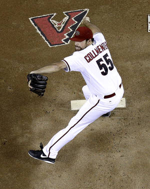 Photo - Arizona Diamondbacks pitcher Josh Collmenter throws against the San Francisco Giants during the first inning of a baseball game on Friday, June 20, 2014, in Phoenix. (AP Photo/Matt York)