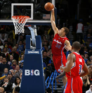 Photo - Los Angeles Clippers' Blake Griffin (32) dunks the ball during an NBA basketball game between the Oklahoma City Thunder and the Los Angeles Clippers at Chesapeake Energey Arena in Oklahoma City, Thursday, Nov. 21, 2013. Photo by Bryan Terry, The Oklahoman