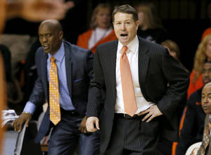 Photo - Oklahoma State coach Travis Ford shouts instructions during an NCAA college basketball game between the Oklahoma State Cowboys (OSU) and the University of Texas Longhorns at Gallagher-Iba Arena in Stillwater, Okla., Wednesday, Jan. 8, 2014. Oklahoma State won 87-74. Photo by Bryan Terry, The Oklahoman