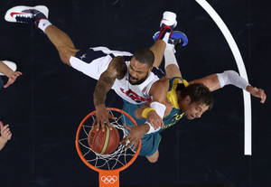 Photo -   In this Wednesday, Aug. 8, 2012 file photo, United States' Tyson Chandler dunks against Australia's David Andersen during a men's quarterfinals basketball game at the 2012 Summer Olympics, in London. (AP Photo/Charles Krupa, File)