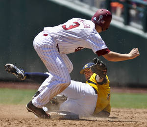 Photo -   South Carolina's Tanner English, top, safely steals second base against Kent State shortstop Jimmy Rider during the sixth inning of an NCAA College World Series elimination baseball game in Omaha, Neb., Thursday, June 21, 2012. (AP Photo/Eric Francis)