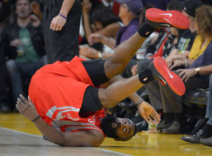 Photo -   Houston Rockets guard James Harden rolls over after being fouled by Los Angeles Lakers guard Jodie Meeks during the first half of their NBA basketball game, Sunday, Nov. 18, 2012, in Los Angeles. (AP Photo/Mark J. Terrill)
